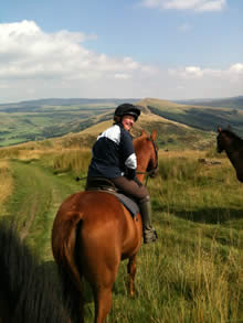 Horse and rider posing for a photograph on the bridleway.
