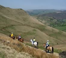 Four horseriders following the Pennine Bridleway.