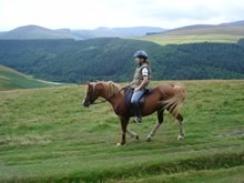 Horserider with the spectacular Peak District scenery in the background.